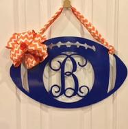 Wood football monogram can be personalized with your favorite university or college colors.