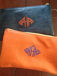3 ways to wear this monogrammed purse-crossbody, wristlet or clutch.  Choose from over 10 colors, monogram or personalize.