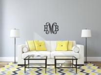 Classic wood monogram in birchwood, painted in your color choice.  Side initials are print and center initial is script.