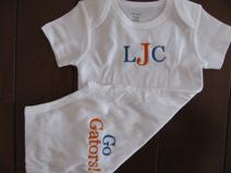 Gator onesie or greek onesie embroidered on both sides for the little college fan.