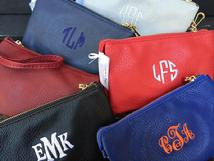 Crossbody monogrammed bag, clutch and wristlet.