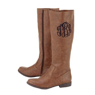 "Brown monogrammed riding boots with 1"" heel."