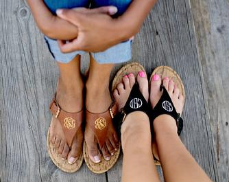 Brown or Black monogrammed sandals.